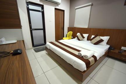 Foton av Hotel Embassy Kalol