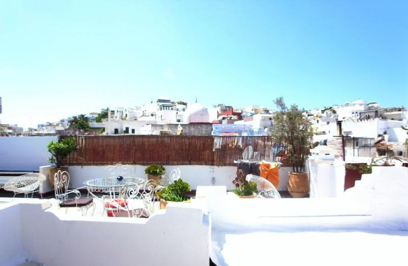 The rooftop lounge on top the Melting Pot hostel in Tangier, Morocco on a beautiful summers day.